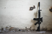 Airsoft Rifle On An Old Wall B...