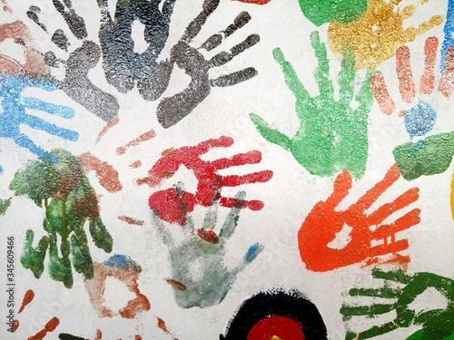 Vászonkép Colorful Handprints On Wall