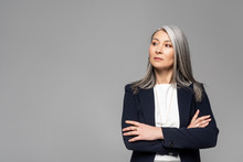 Confident Asian Stylish Businesswoman With Grey Hair And Crossed Arms Isolated On Grey