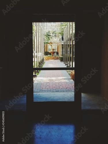 Fototapeta Courtyard Seen Through Door