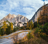 Autumn morning alpine Dolomites mountain scene. Peaceful Valparola Pass view, Belluno, Italy.