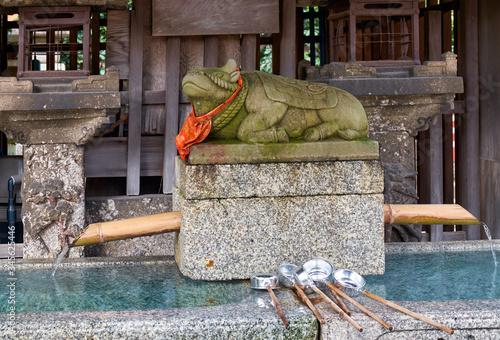 Water ablution pavilion (temizuya) with the lying ox statue at Kitano Tenmangu shrine Canvas Print