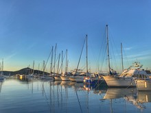 Boats Moored At Harbor Against...