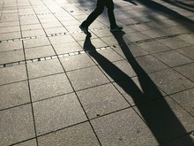 Shadow Of Walking Person