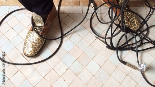 Photo Tangled Cables Along Legs On The Floor