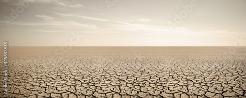 Fotografia, Obraz Panorama of dry cracked desert. Global warming concept