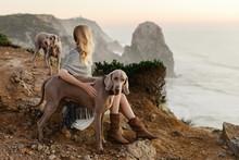 Blond Woman Sitting On A Sea C...