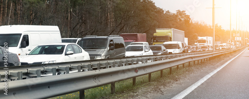 Fotografía Highway interstate road with car traffic jam and tree forest on background