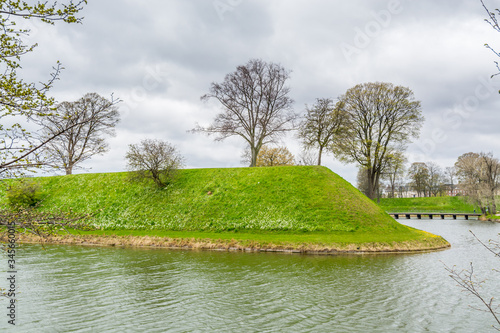 The citadel in Copenhagen, normally referred to as Kastellet, is a well-preserved, star-shaped fortress that was built in the 17th century to guard the approach to the harbour Canvas Print
