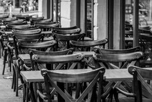 Empty Chairs And Tables Arranged In Sidewalk Cafe