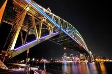 Low Angle View Of Illuminated Suspension Bridge At Night