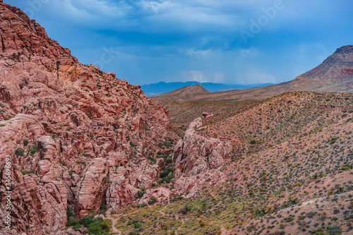 The desert environment inside Red Rock Canyon State Park in Las Vegas, Nevada, USA with storm clouds brewing overhead.