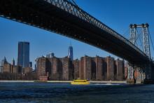 Yellow- Boat- Williamsburg- Bridge- One World Trade Center- East River- New York City- Manhattan- United States- USA.