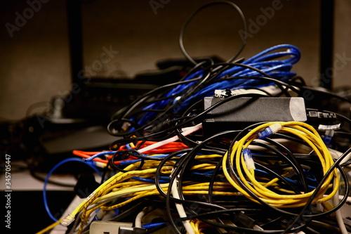 Obraz na plátně Close-up Of Tangled Cables In Server Room