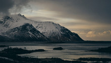 Sunset Over Snowy Mountains And Bay