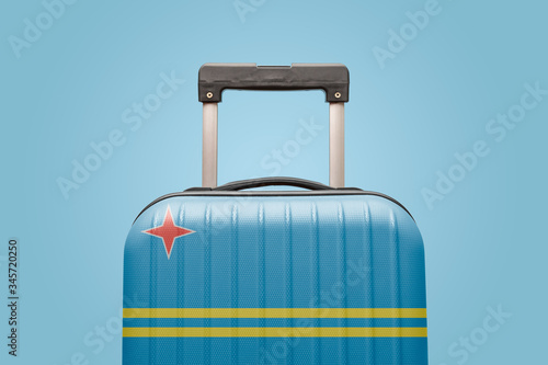 Baggage with Aruba flag print tourism and vacation concept. Canvas Print