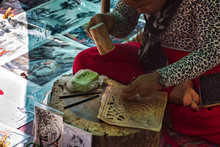A Local, Cambodian Woman Is Sitting And Preparing Colorful, Traditional Handcrafted Pictures With Khmer Cultural Motives
