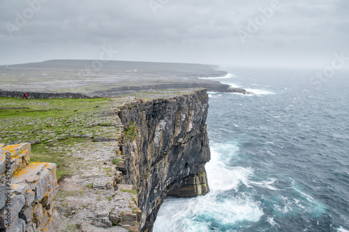 Waves crashing at the base of a steep cliff at Aran Islands, Ireland Canvas Print