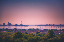 Landscape Of The Skyline In Portsmouth, UK Showing Spinnaker Tower, Gunwharf Quays, Portsmouth Harbour And Surrounding Area.