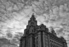 Low Angle View Of Royal Liver Building Against Cloudy Sky