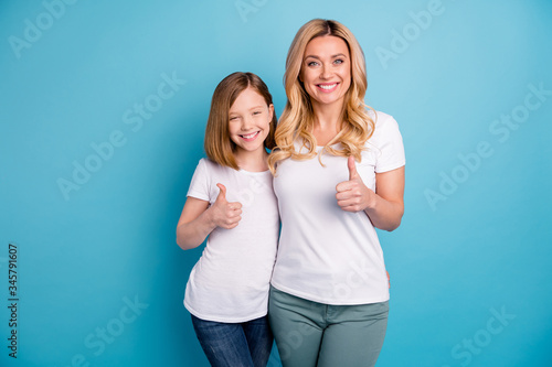 Fotografie, Tablou Photo of two people attractive mommy lady little daughter hold thumb fingers rai