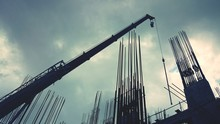 Low Angle View Of Iron Rods And Crane Against Sky