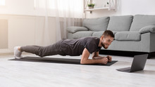 Young Man Doing Plank Exercise...