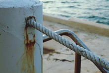Close-up Of Rope By Pole At Be...