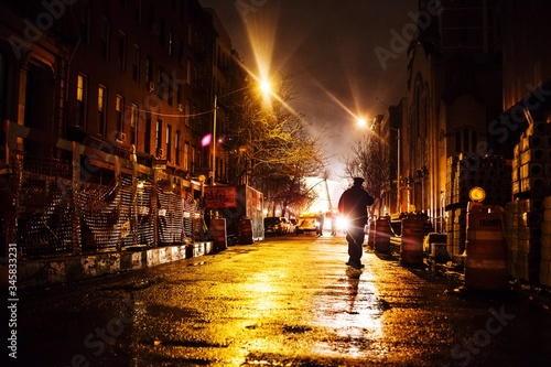 Fényképezés Man Walking Along Empty Back Street At Night