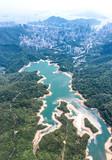 Aerial view of Shing Mun Reservoir, looking far away to urban area