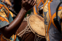 A Closeup Photo Shows A Drum And A Drummers Hands At The Yam Festival In Ghana, West Africa.