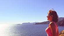 Woman Enjoy Sea Breeze.