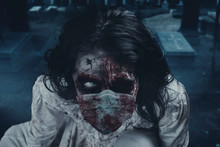 Creepy Female Zombie Wearing F...