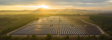 Aerial View Of The Solar Panel With A Sunny Sky At Sunrise.  Concept Of Clean Energy Conservation. Banner Panorama Background