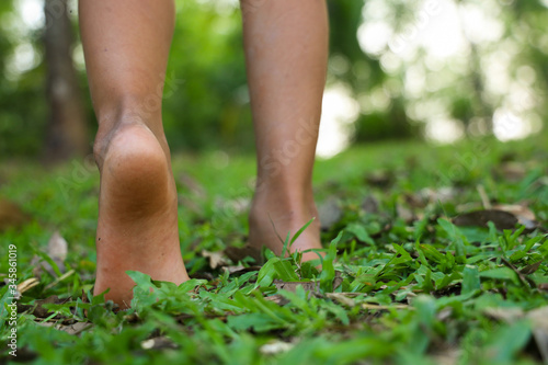 Fotografía Heels of children walking on the grass