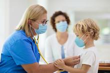 Doctor Examining Sick Child In...