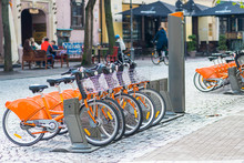 Sustainable Transport. Row Of Bikes Parked For Hire In The Old Town, City Bikes Rent Parking, Public Bicycle Sharing System, Bike Sharing Program