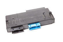 Plastic Electronic Control Unit With Black And Blue Connectors On A White Isolated Background In A Photo Studio. Spare Part For Sale Or Repair Of Car Electronics In A Car Service.