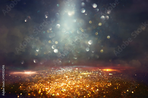 Fototapeta background of abstract glitter lights. gold and black. de focused obraz