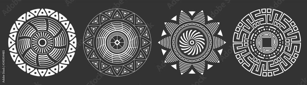 Fototapeta Set of four abstract circular ornaments. Decorative patterns isolated on black background. Tribal ethnic motifs. Stylized sun symbols. Stencil tattoo and prints Vector monochrome illustration.