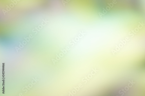 multicolor abstract background of blended pastel shades of yellow, green, purple Wallpaper Mural
