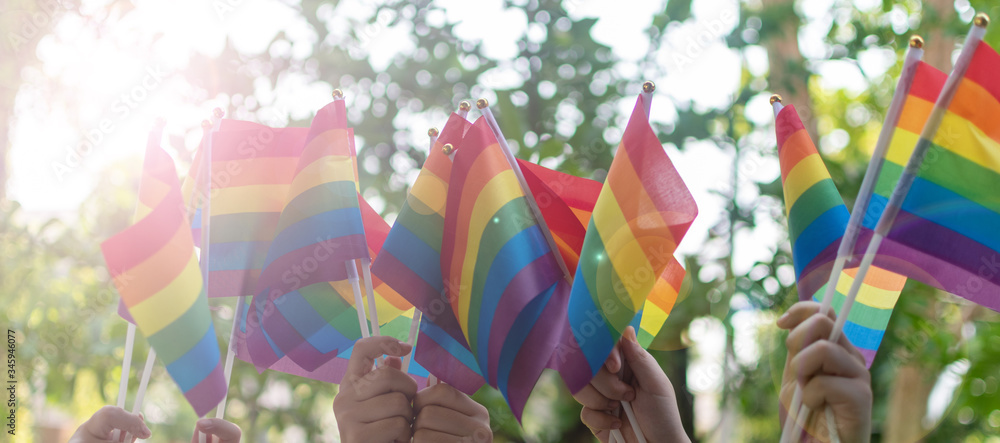 Fototapeta LGBT, pride, rainbow flag as a symbol of lesbian, gay, bisexual, transgender, and queer pride and LGBTQ social movements in June month