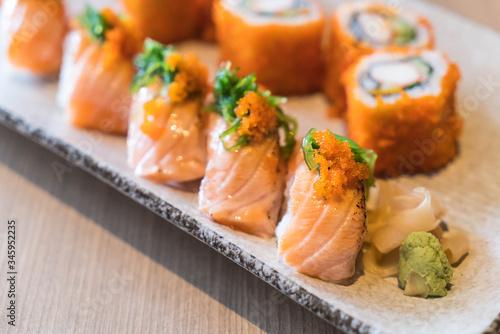 Fototapeta salmon sushi and salmon maki obraz