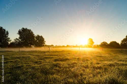 Leinwand Poster Idyllic Shot Of Sunlight On Landscape Against Sky