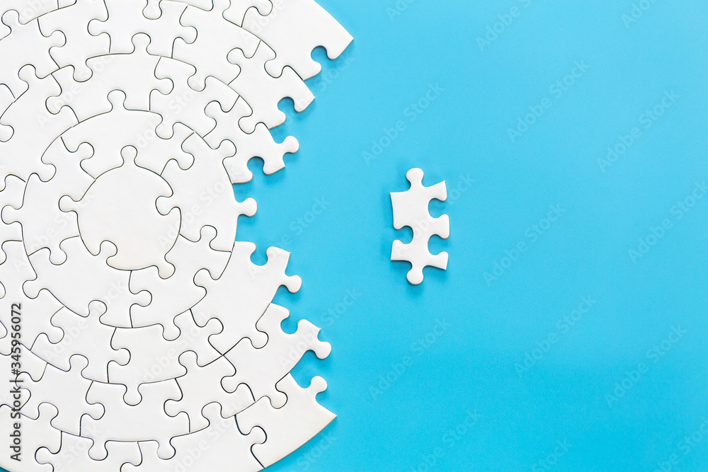 Fototapeta White jigsaw puzzle pieces on a blue background. Problem solving concepts. Texture photo with copy space for text