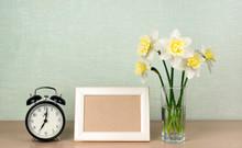 A Bouquet Of Daffodils In A Va...