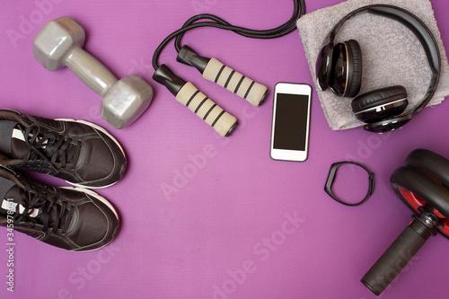 Fitness equipment on purple mat Fototapet