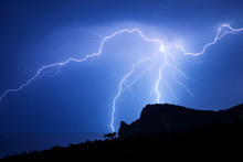 Powerful Lightning Over A Rock...