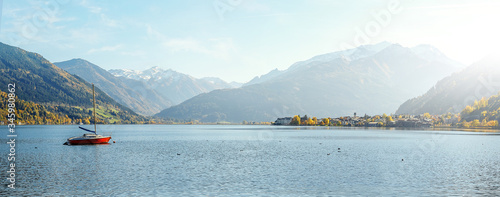 Wall mural - Stunning Nature Landscape. Wonderful Sunny day in Autumn. Panoramic view of beautiful mountain landscape in Alps with Zeller Lake in Zell am See, Salzburger Land, Austria