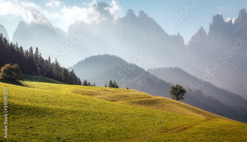 Wall mural - Fairy velley in Dolomites mountains under sunlit. Amazing nature Background. Epic Scenery